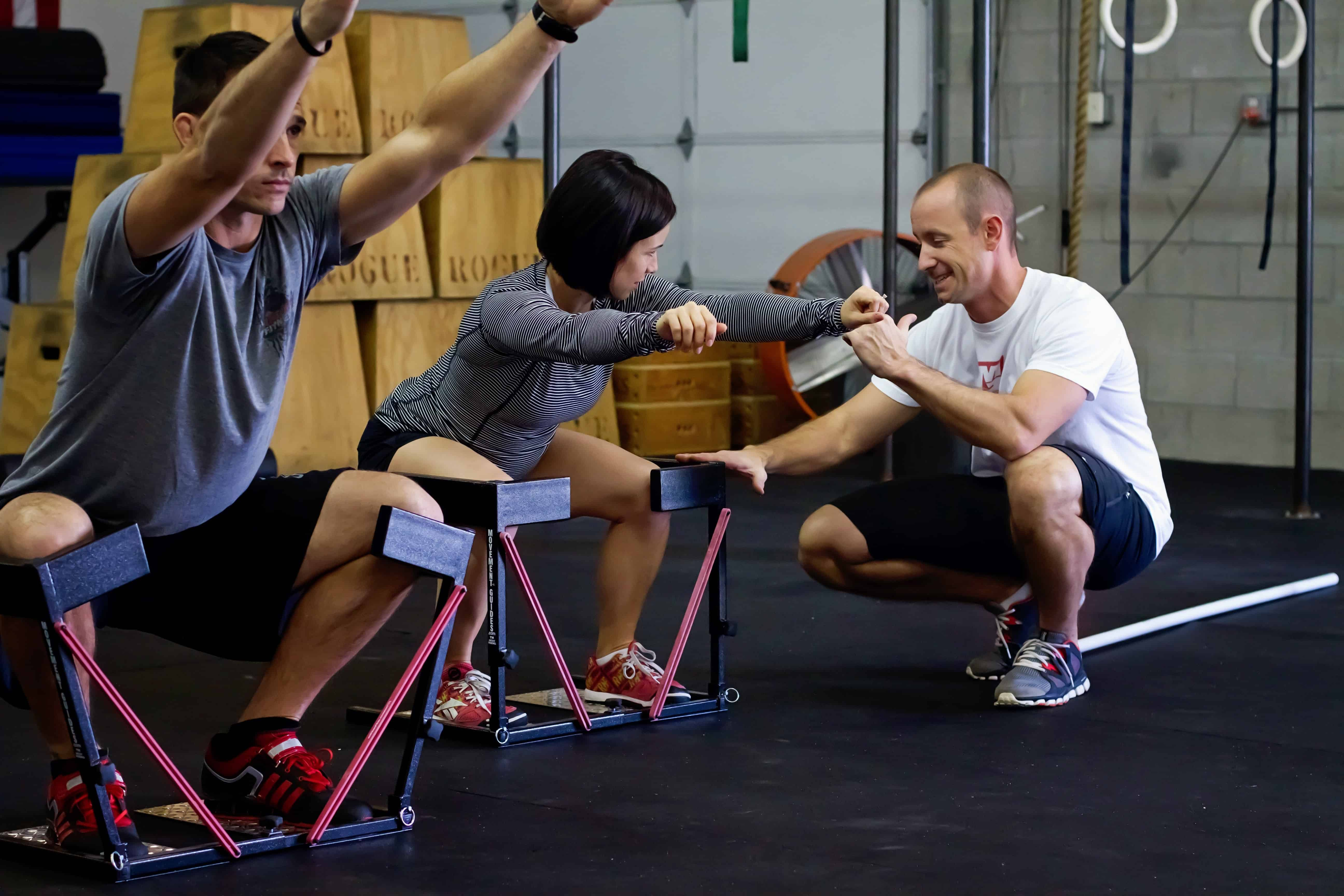 Teaching an athlete how to properly squat in the SquatGuide
